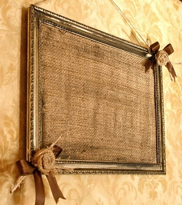Grunged Burlap Bulletin Board...in a distressed frame with ribbon & burlap rosettes... Could we do something like this with pictures of them in it??