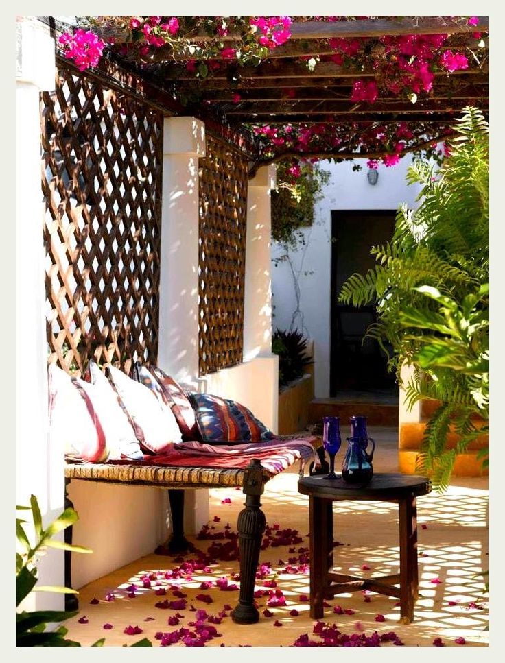 Pergola +Trellis + Tables.  Simple and lovely,  tables can be brought indoors.  Pergola: add bunting or lights (instead of bougainvillea).  Add a big pot plant.