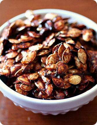 Sweet & Salty Roasted Pumpkin Seeds - just made these and they were great!  Can use brown sugar too!