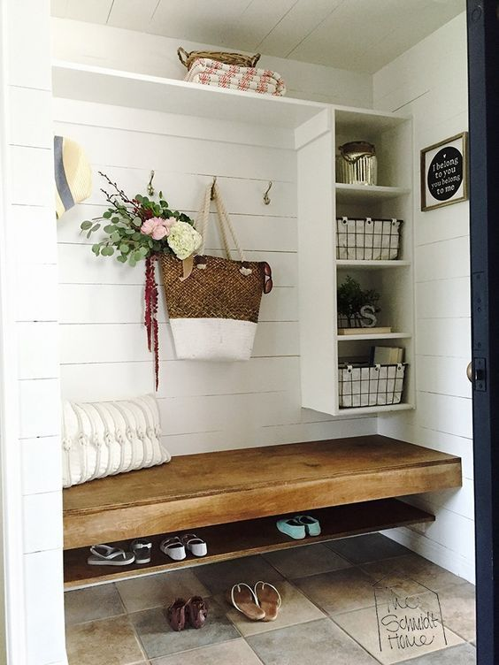 Farmhouse Touches in a laundry room - shiplap walls and shelf storage with wood countertop