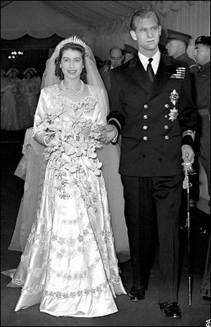 """Lieutenant Philip Mountbatten and his bride, Princess Elizabeth of York, on their wedding day.  On the morning of his wedding Philip, who'd renounced his Greek and Danish titles, was given the style """"His Royal Highness"""" and the title """"Duke of Edinburgh"""" by his new father-in-law, King George VI."""
