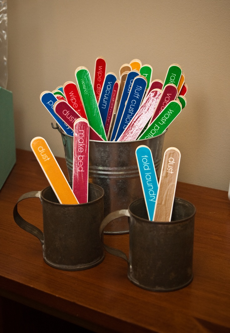 chore sticks - done! printed on paper, color-coded by room, modge-podged to craft sticks.