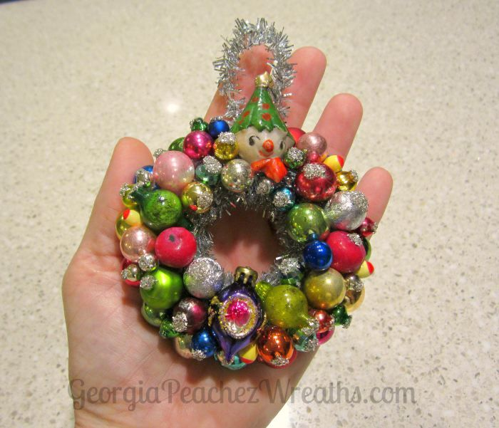 This wreath, made with vintage glass beads and ornaments measures a whopping 3.5″ across.