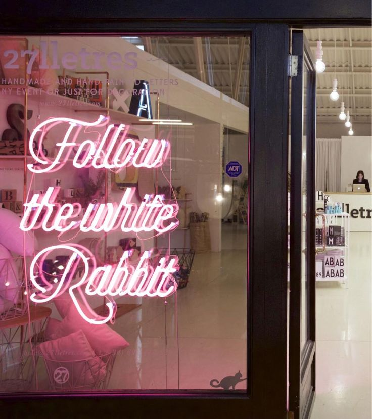 'Follow the white rabbit' Neon in the Barcelona, Spain store 27lletres