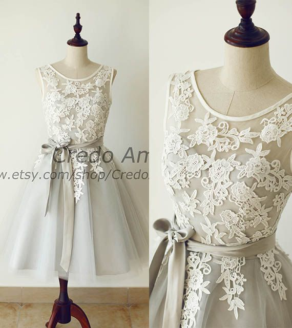 Lovely color combo of ivory and silver gray. Modest front neckline with deep V back. Extra lace appliques on the skirt and then faded to plain.