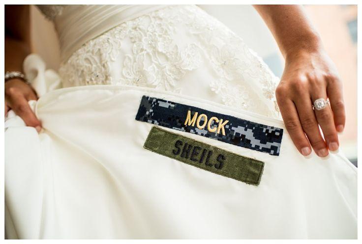Awesome naval academy military wedding ideas. Military name tag sewn into wedding dress
