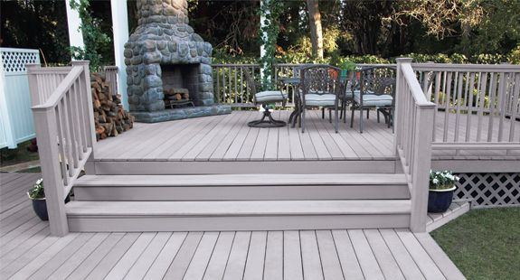 White house with grey deck brown fresh substrate then for Grey composite decking