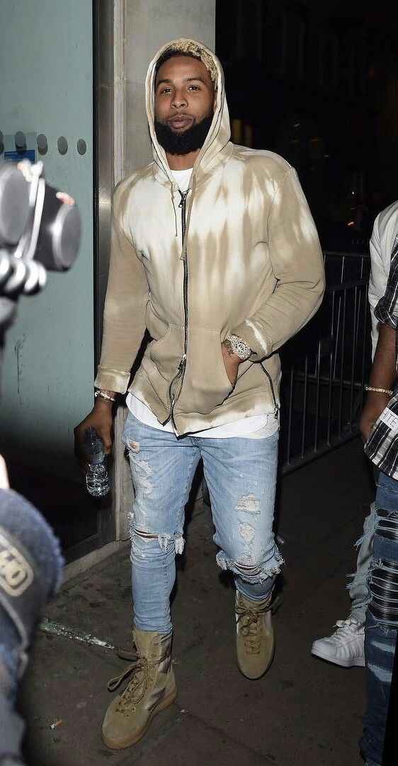 NY Giants wide receiver Odell Beckham Jr. was spotted in London wearing a Balmain tie-dye print zip hoodie and Amiri thrasher light wash jeans ($750). The NFL player was also wearing a pair of Yeezy Season 3 military boots.