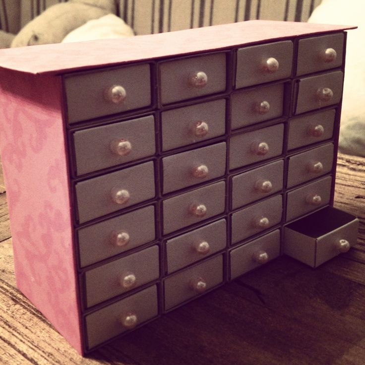 DIY barbie shoe storage pinner stated using matchboxes, glue, beads, pretty paper and some cardboard from a cornflakes box :D super easy and fast DIY project, that the kids can help with too:)