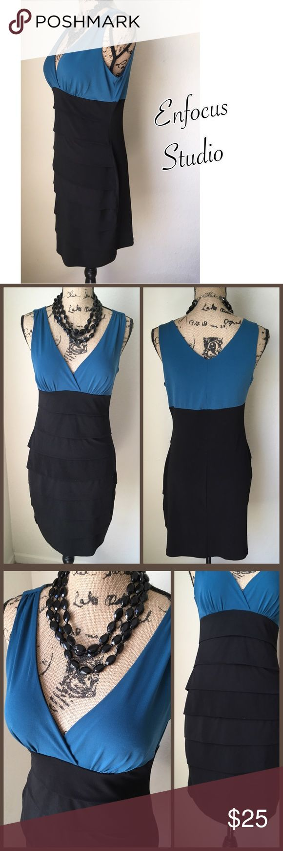Enfocus Studio Cocktail Dress Enfocus Studio Cocktail Dress. Black and Teal with tiered layering. Quality constructed dress in excellent condition. Body con style to contour your curves, lined bodice with lightly padded cups. This dress is even more gorgeous in person! Enfocus Studio Dresses