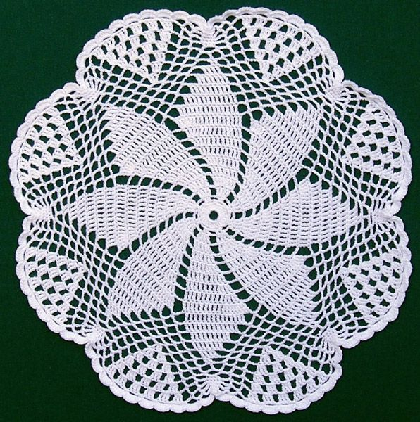 Pinwheel Doily - 13 inch Diam.  By Christina Opp Knapp   born July 9, 1901, McPherson County, South Dakota  From the Opp-Knapp family collection. Photo courtesy of Jeff Taylor.