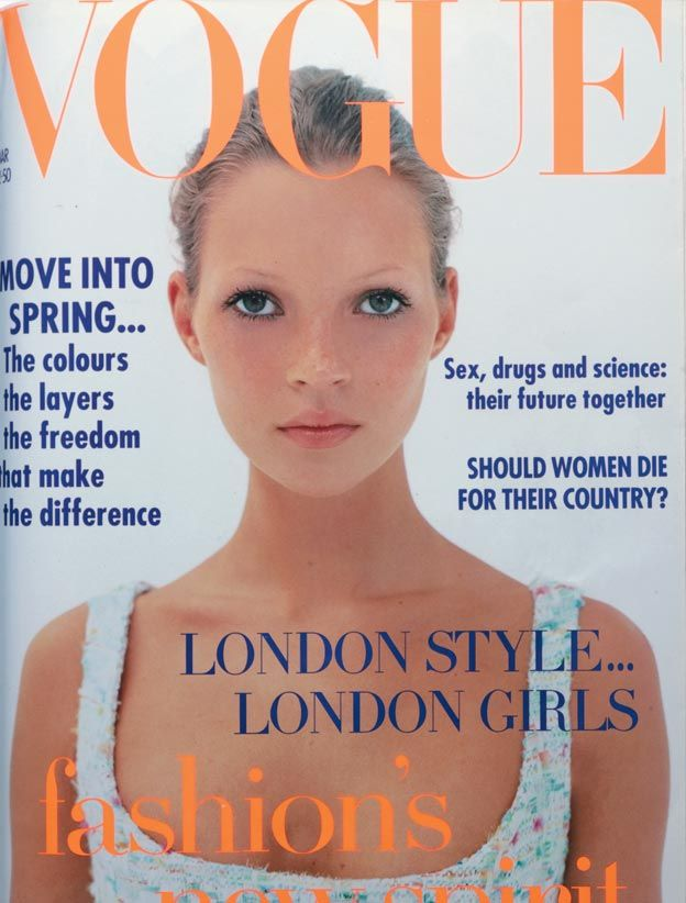 March 1993 London girl, London style. Kate Moss wears pale pink and ice-blue tweed bustier, from £1,900, sold with matching cropped jacket, at Chanel Boutique. All make up by Chanel. Photography: Corinne Day. Hair: James Brown at Brinks & Huck MARCH 1993 - Kate Moss appeared on her very first Vogue cover wearing a simple ponytail and spring-inspired make-up from Chanel.