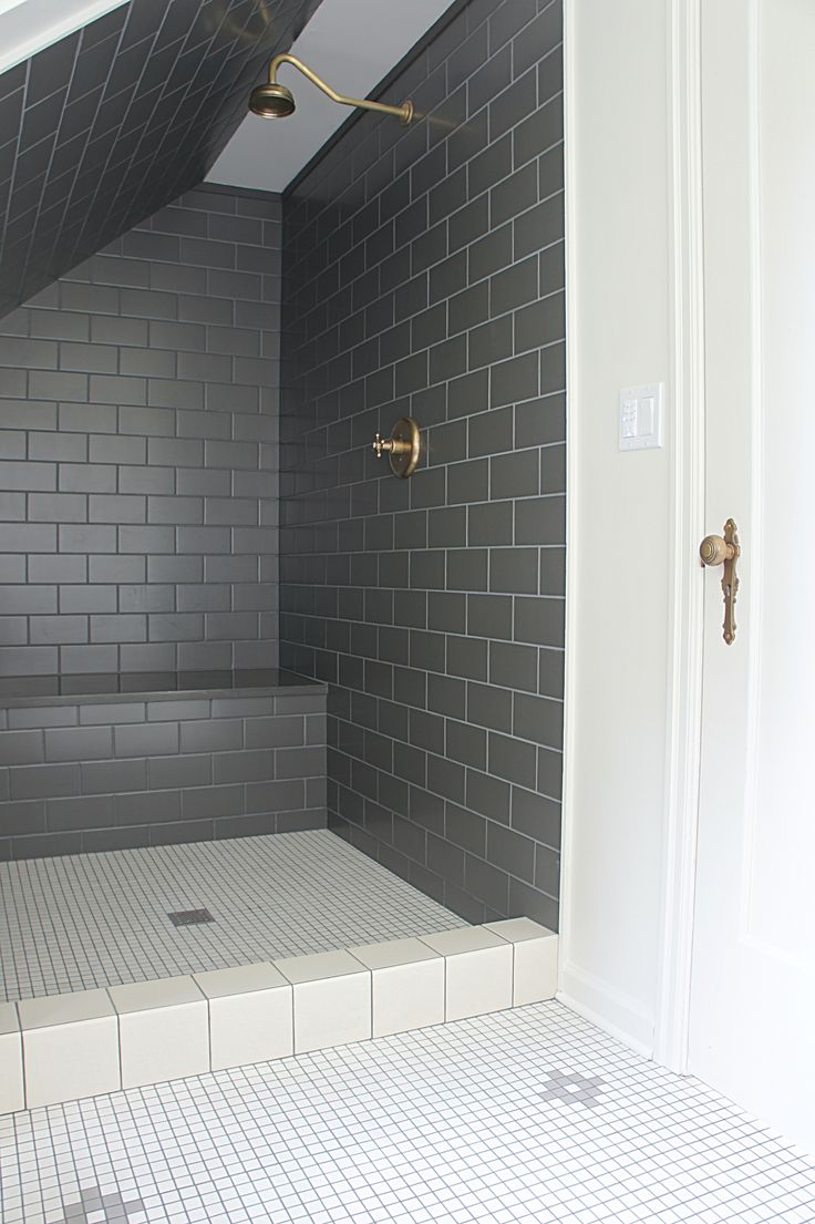Antique white bathroom vanity buy or sell bath amp bathware in ontario - Clad In Black Subway Tiles Sloped Shower Features A Tiled Bench A Vintage Brass Gooseneck Shower Head And White Grid Floor Tiles