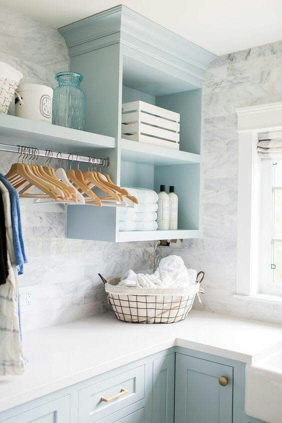 love the countertop color with the light blue cabinets and wall application
