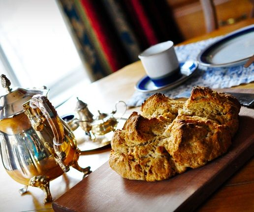 This wonderful soda bread is tender and rich, made with whole grains and rounded out by breakfast tea infused milk. Goes great with cheese and butter!