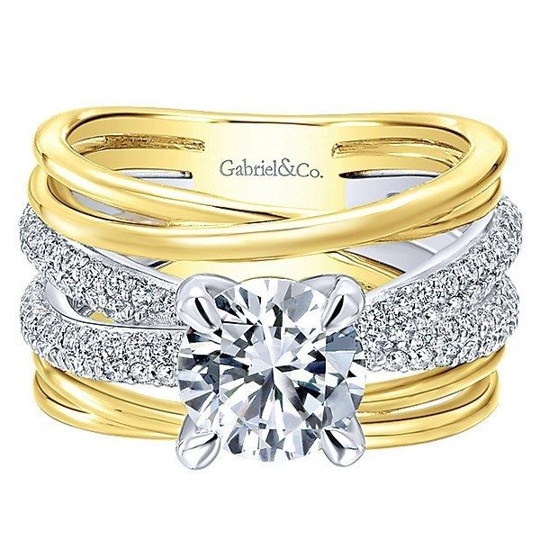 18K Yellow and White Gold Stacked Twisted Style Diamond Engagement Ring. This ring features .70cttw of round diamonds with a two-tone multi-band stacked style of yellow and white gold. Features 3 cros