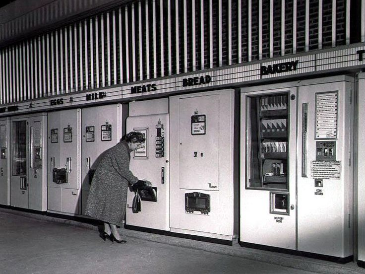 Vintage vending machines. Bakery, bread, eggs. Woman in coat and heels