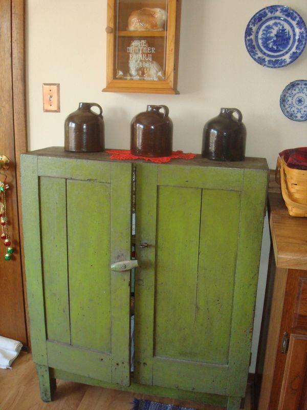 Green primitive cabinet.