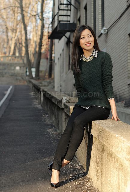 collared shirt under crewneck cableknit sweater w/ pearls