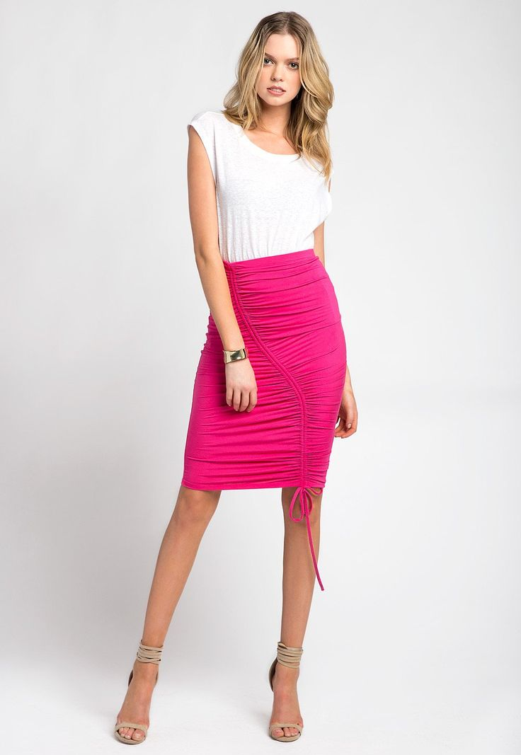 Sexy and Chic Hot Pink Midi Skirt with Ruched Effect and Pull Tie. COLOR Hot Pink FABRIC 95% Rayon, 5%Spandex STYLE Midi Skirt AVAILABILITY In Stock - Ships wi