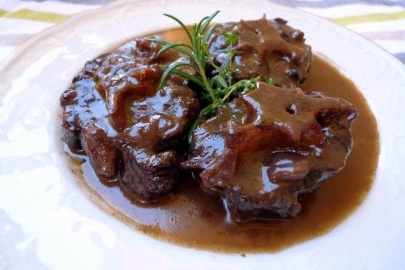 Rabo de Toro i.e. oxtail is a traditional Spanish food with extremely tender meat. This recipe presents a proper way of doing it: let the meat boil in the sauce (which contains one bottle of red wine!) for 3 hours.
