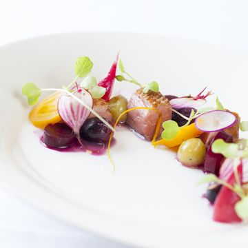 Roasted duck with heritage beetroots, soy roasted grapes and young herbs. | FOUR Magazine
