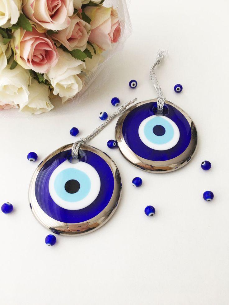 https://www.etsy.com/listing/491992456/silver-evil-eye-bead-7cm-evil-eye-wall evil eye bead - 7cm - evil eye wall hanging - evil eye charm - large evil eye- nazar bead - nazar boncuk - evil eye decor  It is 7 cm evil eye wall hanging (evil eye bead)  It comes with silver rope - ready for wall hanging or car rear view mirror charm #evileye #evileyes #evileyebeads #largeevileye #weddingfavors #nazarboncuk #nazarbeads #evileyedecor #babyshowergift #weddingift #silverevileye