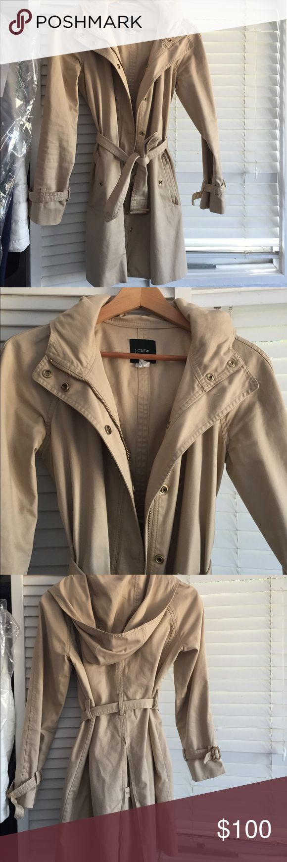 Jcrew trench coat with hood size 0 Jcrew hooded trench coat size 0 only ever dry cleaned. In great condition. Mid thigh length J. Crew Jackets & Coats Trench Coats