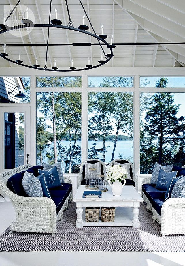 Sunroom. Sunroom Furniture Ideas. Sunroom with White wicker furniture with nautical-themed decor. #Sunroom #PatioFurniture #PatioDecor