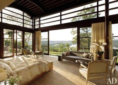Views of the countryside are available from the wall windows of the master suite of a Litchfield, Connecticut, home, or from the adjoining terrace | archdigest.com