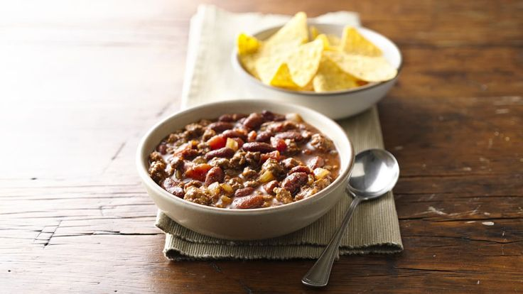 Slow Cooker Three-Bean Chili recipe and reviews - You won't miss the meat in a spicy chili brimming with three kinds of beans.