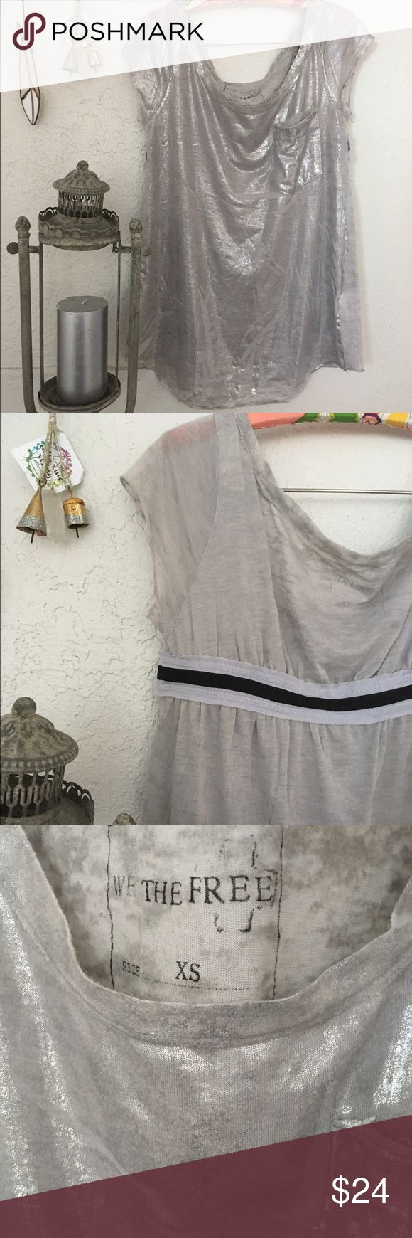 Free People Metallic Silver Tee Super cute top the front is all metallic textured with a cute pocket and the back has an elastic line that make the top unique!!!wear it up with a free people slip or down with your denims Free People Tops Tees - Short Sleeve