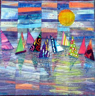 """'Regatta' by Judy Alexander. """" I started this by digging in my scrap bin for any fabric that looked like sky and/or water. I cut them in stripes and pieced about a 14' x 14' block. Then I cut it in 5 random widths, staggered them and pieced them back together. I then placed the sailboat reflections, covered them with a little Angelina fiber and a layer of organza. Next some quilting and then a layer of tulle and more quilting. I then put the sailboats on top and stitched them down. """""""
