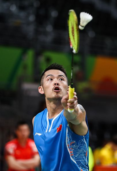 Lin Dan of China competes against Vladimir Malkov of Russian in the badminton…