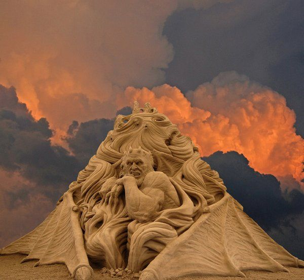 Amazing sand sculpture with amazing clouds!