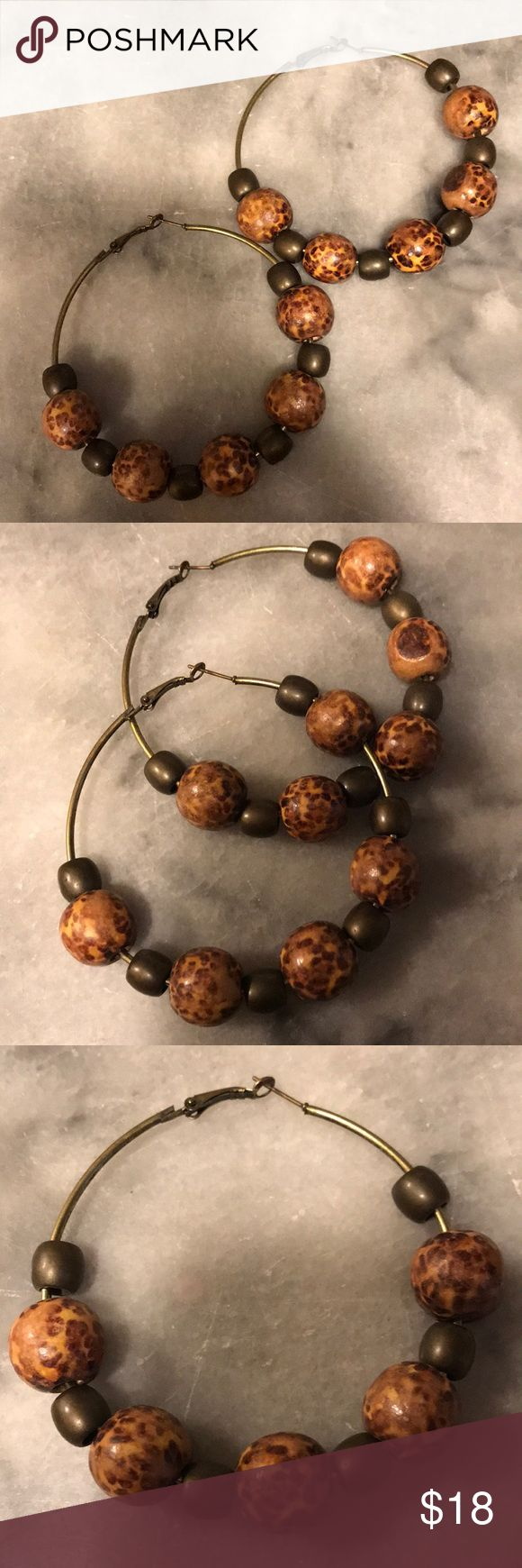 Kenyan Hoop Earrings Wooden animal print beads and olive green beads on antique gold/brass toned hoops. Gorgeous large hoops purchased at a market in Kenya. Jewelry Earrings