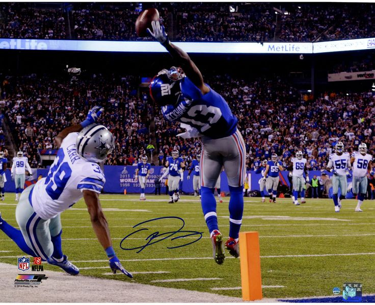 Odell Beckham Jr's Signed One-Handed Touchdown Catch 16x20 Photo This 16x20 photo has been personally hand-signed by Football star and Giants Wide Receiver Odell Beckham Jr. 100% Guaranteed AuthenticI
