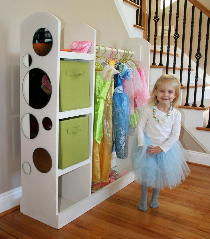 Taegan loves princesses and dressing up like a princess so for her birthday Brandon and I made her this cute dress-up storage center. It r...