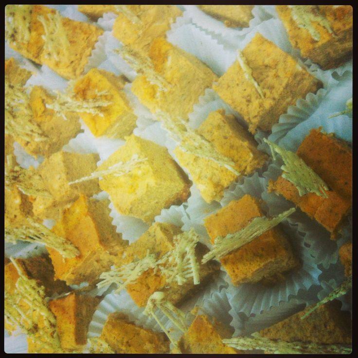 Pumpkin cheesecake bites garnished with white chocolate sprinkled with nutmeg! Yummo!!