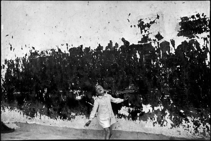 Cartier-Bresson, Henri. Girl by Wall. Photograph. magnumphotos.com. Magnum Photos. 15 May 2017.