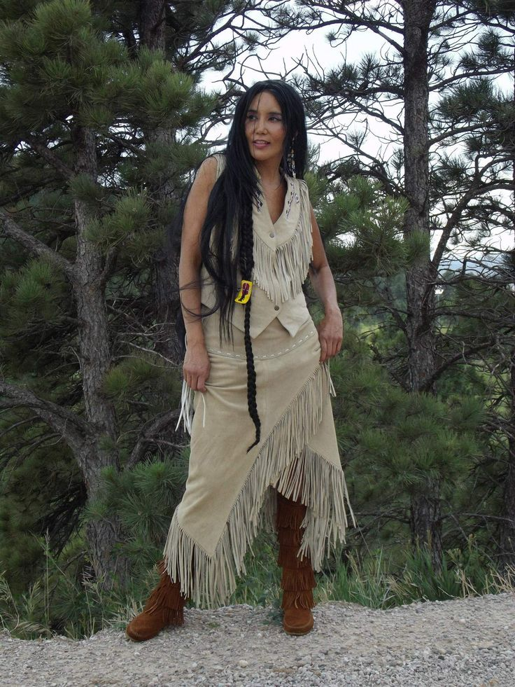 Top Native Model And Actress Junal Gerlach Wearing Tribal Impressions Five Layer Minneonka Zipper Boots, The J4 West Beaded Wolf Vest With Matching Fringed Skirt. Review the collections off of: http://www.indianvillagemall.com/vestladywolf.html For more information on Native Actress and Model Junal Gerlach, go to: http://www.junalgerlach.com/: