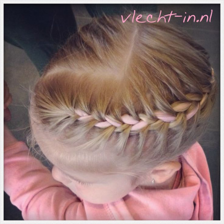 French braid with pink ribbon. www.vlecht-in.nl