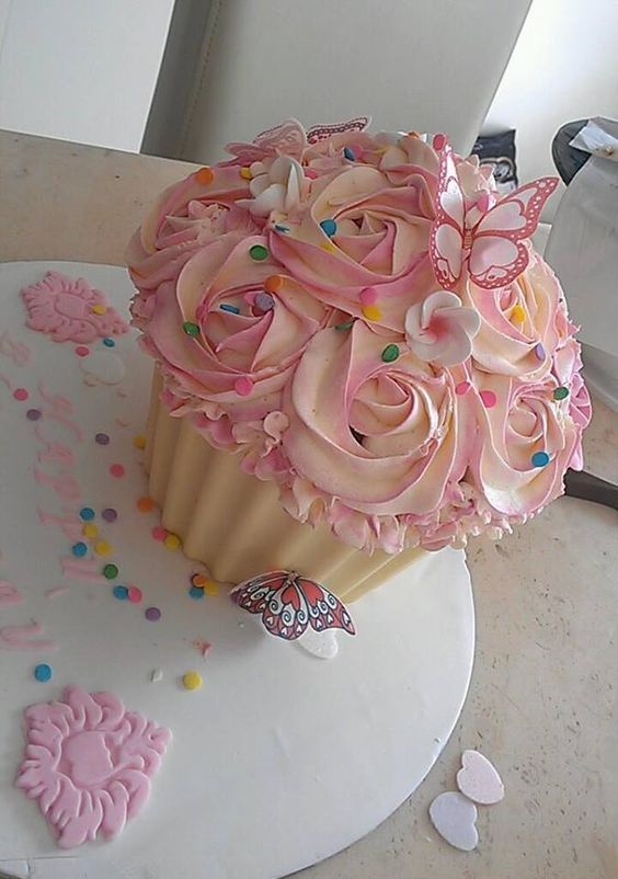 Giant Cupcake: Raspberry & Coconut caked filled with lemon curd and topped with a cream cheese frosting, in a white Chocolate Shell and dressed with edible butterflies. For my Mum....