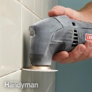Remove old grout from between tiles with carbide grit or diamond blades in an oscillating tool.