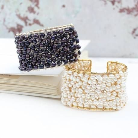 Stunning and lovely, this modern pearl cuff features white or black peacock freshwater pearls with silver or gold plated copper. A real modern statement bracelet.