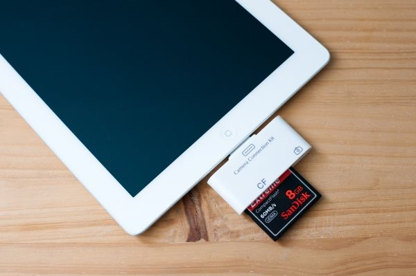 There's been an SD card reader out there for the iPad since the beginning.  But here's one that does CF too!