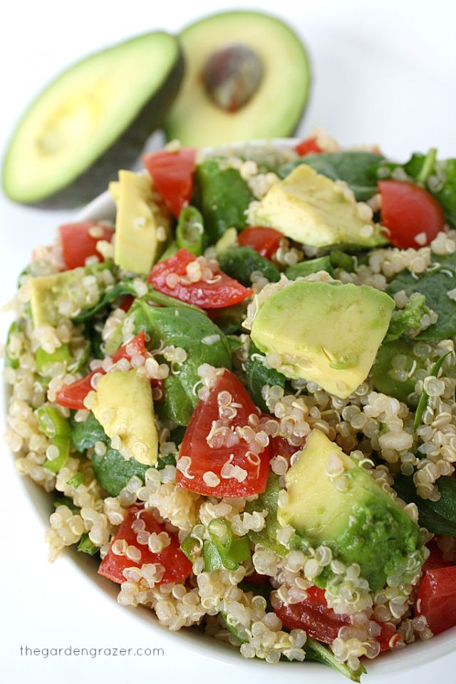 Looks like quinoa, avocado, tomato,baby spinach...