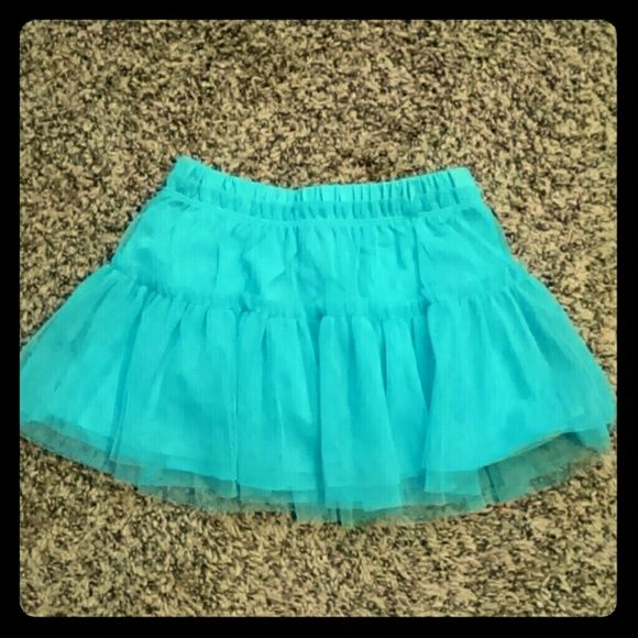 NWOT Baby girls tutu skirt ADORABLE!!! Never worn. Turquoise colored skirt with diaper cover underneath and two cute layers of turquoise tulle. Can't you just imagine your baby girl or niece or Goddaughter in this? SO CUTE!! Okie Dokie Skirts