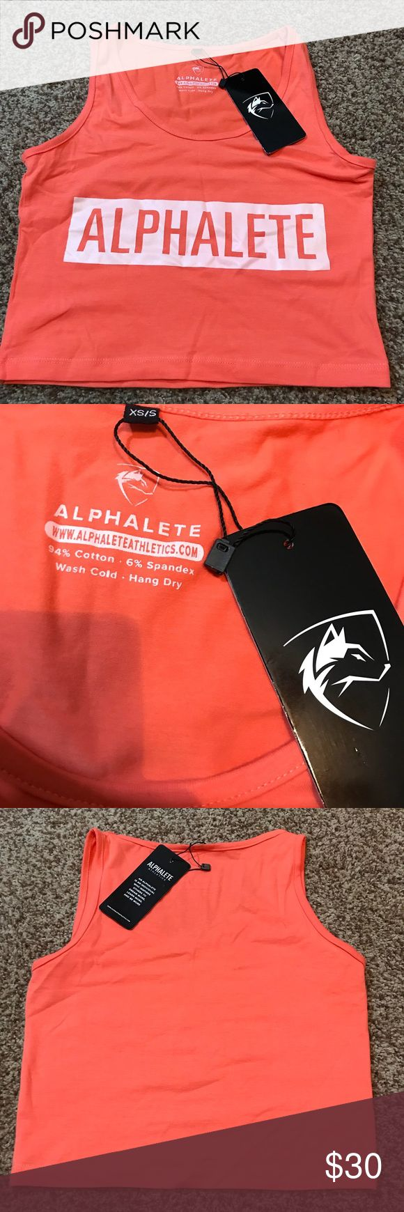 NWT ALPHALETE athletics crop size xs/s NWT ALPHALETE athletics crop size xs/s- has stretch. Coral shirt with white logo. Alphalete Tops Crop Tops