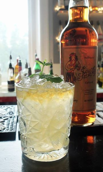 Mai Tai with Spiced Rum Recipe: - 11/2 oz Spiced Sailor Jerry Rum - 1/2 oz Cointreau - 3/4 oz Fresh Lime Juice - 1/4 oz Orgeat Syrup - 1/4 oz Overproof Rum Float Glass: Rocks Ice: Crushed Method: Shake, strain and float Garnish: Mint sprig
